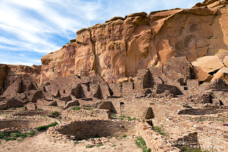 Exterior ruins of Pueblo Bonito at Chaco Culture National Historical Park in New Mexico. Pueblo Bonito was constructed in stages between AD 850 to AD 1150 by the ancestral Puebloan peoples and is considered the center of the Chacoan world.