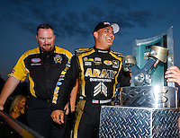 Sep 3, 2016; Clermont, IN, USA; NHRA top fuel driver Tony Schumacher celebrates alongside Brian Lohnes after winning the Traxxas Shooutout speciality race during qualifying for the US Nationals at Lucas Oil Raceway. Mandatory Credit: Mark J. Rebilas-USA TODAY Sports