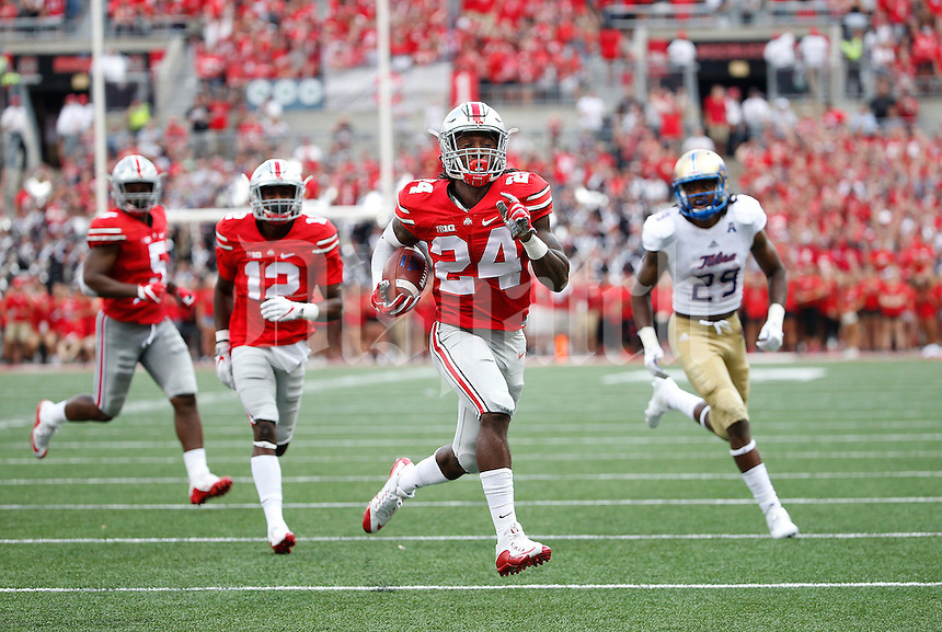 Ohio State Buckeyes safety Malik Hooker (24) returns an interception for a touchdown during the second quarter of the NCAA football game between the Ohio State Buckeyes and the Tulsa Golden Hurricane at Ohio Stadium on Saturday, September 10, 2016. (Columbus Dispatch photo by Jonathan Quilter)