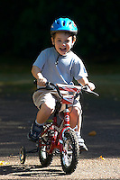 Josh riding small Raleigh bike  ..Virginia Water , Surrey , Sept 2003..