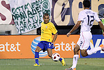 10 AUG 2010: Dani Alves (BRA) (2) is watched by Jonathan Bornstein (USA) (12). The United States Men's National Team lost to the Brazil Men's National Team 0-2 at New Meadowlands Stadium in East Rutherford, New Jersey in an international friendly soccer match.