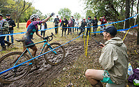 NWA Democrat-Gazette/BEN GOFF @NWABENGOFF<br /> Rebecca Gross of the United States grabs a dollar bill from the fishing pole of Taylor Young, a spectator from Bentonville, while competing in the UCI Elite Women race Sunday, Oct. 6, 2019, during the the Fayettecross cyclocross races at Centennial Park at Millsap Mountain in Fayetteville.