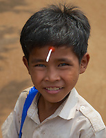 School is out,  Young Boy with a dart on his face  on Silk Island outside Phnom Penh, Cambodia. Home of the Traditional Khmer Silk production