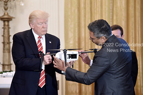 United States President Donald J. Trump holds a drone as George Mathew CEO & Chairman of Kespry explaines how it work during  the American Leadership in Emerging Technology Event in the East Room of the White House in Washington, DC, on June 22, 2017. <br /> Credit: Olivier Douliery / Pool via CNP