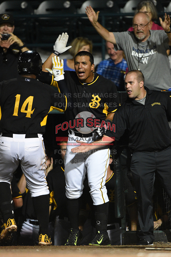 Bradenton Marauders first baseman Jose Osuna (24) high fives Edwin Espinal (14) after scoring a run during a game against the Charlotte Stone Crabs on April 22, 2015 at McKechnie Field in Bradenton, Florida.  Bradenton defeated Charlotte 7-6.  (Mike Janes/Four Seam Images)