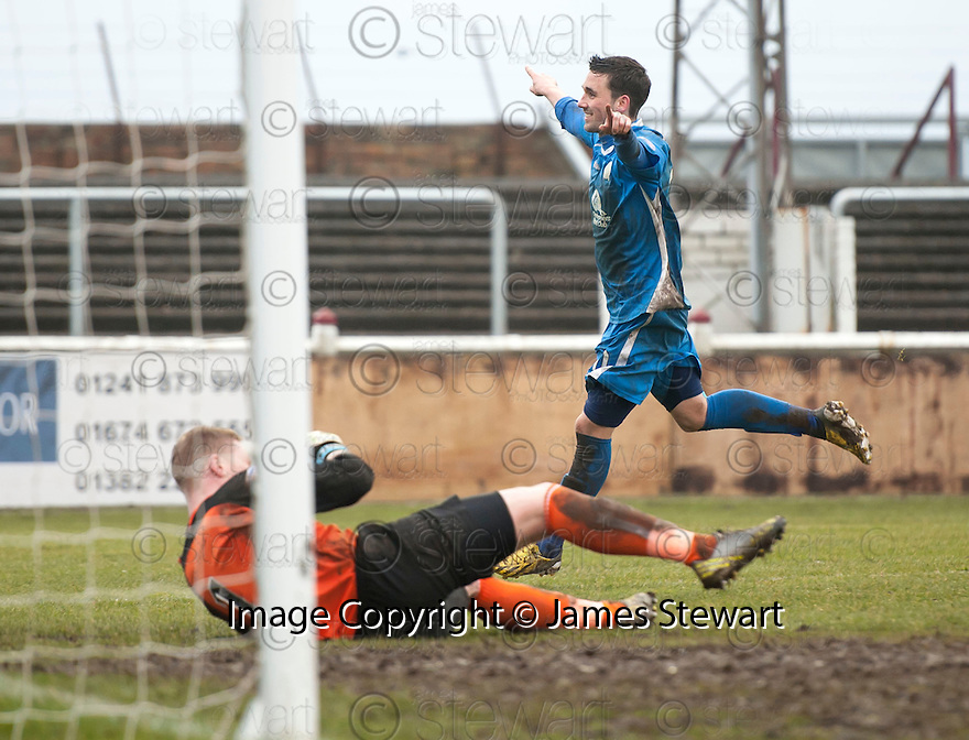 Queen of the South's Nicky Clark celebrates after he scores their late equaliser as Arbroath keeper Scott Morrison holds his head.