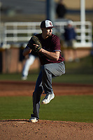 Concord Mountain Lions relief pitcher Anthony Stehlin (12) in action against the Wingate Bulldogs at Ron Christopher Stadium on February 2, 2020 in Wingate, North Carolina. The Mountain Lions defeated the Bulldogs 12-11. (Brian Westerholt/Four Seam Images)