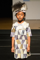Model walks runway in an outfit by Bleu Comme Gris, during the petitePARADE Children's Club fashion show at the Jacob Javits Center in New York City, on January 9, 2016.