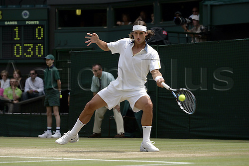29 June 2005: Spanish player Feliciano Lopez (ESP) playing a forehand during his quarter final match against Hewitt at the All England Lawn Tennis Championships, Wimbledon, London. Hewitt won the match 7-5, 6-4, 7-6. Photo: Glyn Kirk/Actionplus..050629 man male mens gentlemens