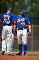 GCL Mets pitching coach Royce Ring (40) visits with pitcher Max Wotell (30) during the first game of a doubleheader against the GCL Marlins on July 24, 2015 at the St. Lucie Sports Complex in St. Lucie, Florida.  GCL Marlins defeated the GCL Mets 5-4.  (Mike Janes/Four Seam Images)