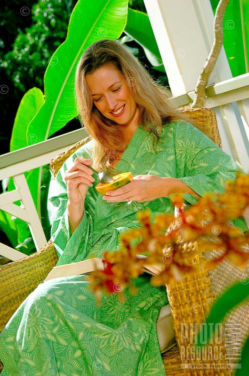 Woman Enjoys Fresh Papaya For Breakfast