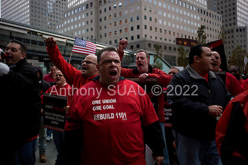 New York, New York<br /> October 21, 2011<br /> <br /> Occupy Wall Street joined Verizon Communications workers in a march to denounce corporate greed as the company and 45,000 employees negotiate a new labor contract.<br /> <br /> The march, to a Verizon store in Lower Manhattan, coincided with the top U.S. mobile provider reporting a third-quarter profit of $1.38 billion, more than double its profit for the same quarter last year.<br /> <br /> Support from unions across the United States has helped boost the ranks of the Occupy Wall Street movement against economic inequality, which began five weeks ago and sparked protests nationwide and globally.