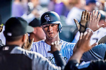 16 September 2017: Colorado Rockies second baseman DJ LeMahieu returns to the dugout after scoring against the San Diego Padres at Coors Field in Denver, Colorado. The Rockies shut out the Padres in a 16-0 route of the second game in their 3-game divisional series. Mandatory Credit: Ed Wolfstein Photo *** RAW (NEF) Image File Available ***
