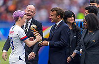 LYON,  - JULY 7: Megan Rapinoe #15 receives her trophy from Emmanuel Macron during a game between Netherlands and USWNT at Stade de Lyon on July 7, 2019 in Lyon, France.