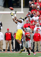 Michigan Wolverines wide receiver Devin Funchess (1) makes a catch in front of Ohio State Buckeyes cornerback Doran Grant (12) during the first quarter of the NCAA football game against Michigan at Ohio Stadium on Saturday, November 29, 2014. (Columbus Dispatch photo by Jonathan Quilter)