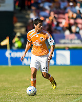 Houston Dynamo forward Brian Ching (25) dribbles the ball. Houston Dynamo tied Los Angeles Galaxy 0-0 at Robertson Stadium in Houston, TX on October 18, 2009.