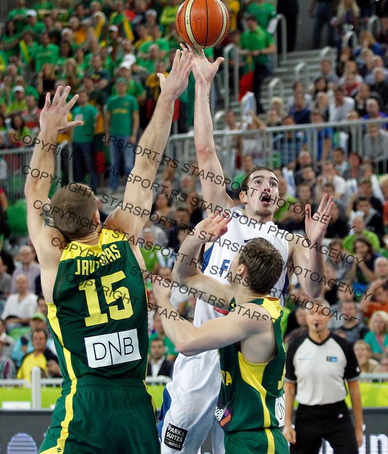 "France`s Nando De Colo in action during European basketball championship ""Eurobasket 2013""  final game between France and Lithuania in Stozice Arena in Ljubljana, Slovenia, on September 22. 2013. (credit: Pedja Milosavljevic  / thepedja@gmail.com / +381641260959)"