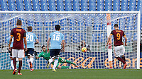 Calcio, Serie A: Roma vs Lazio. Roma, stadio Olimpico, 8 novembre 2015.<br /> Roma's Edin Dzeko, right, scores on a penalty kick during the Italian Serie A football match between Roma and Lazio at Rome's Olympic stadium, 8 November 2015.<br /> UPDATE IMAGES PRESS/Isabella Bonotto