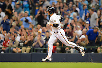 Milwaukee Brewers outfielder Ryan Braun #8 runs the bases after hitting a home run during a game against the Los Angeles Dodgers at Miller Park on May 22, 2013 in Milwaukee, Wisconsin.  Los Angeles defeated Milwaukee 9-2.  (Mike Janes/Four Seam Images)