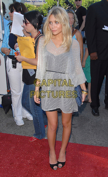 ASHLEY OLSEN.At The 2006 Teen Choice Awards - Arrivals, .held at The Universal Ampitheatre in Universal City, California, USA, August 20th 2006..full length white grey beaded sheer dress over black layered peeptoe shoes blue clutch bag belt bangles bracelets.Ref: DVS.www.capitalpictures.com.sales@capitalpictures.com.©Debbie VanStory/Capital Pictures