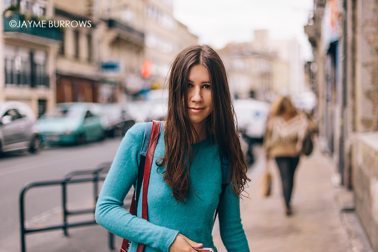 Portrait of a young student walking through the city.
