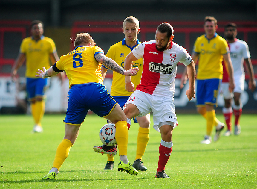 Kidderminster Harriers' Jared Hodgkiss vies for possession with Lincoln City's Alan Power<br /> <br /> Photographer Andrew Vaughan/CameraSport<br /> <br /> Football - Vanarama National League - Kidderminster Harriers v Lincoln City - Saturday 19th September 2015 - Aggborough Stadium - Kidderminster<br /> <br /> &copy; CameraSport - 43 Linden Ave. Countesthorpe. Leicester. England. LE8 5PG - Tel: +44 (0) 116 277 4147 - admin@camerasport.com - www.camerasport.com