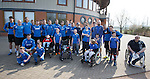 Rangers players with fans as supporters group Sons of Struth take a party of disabled kids on a tour of the training ground this morning