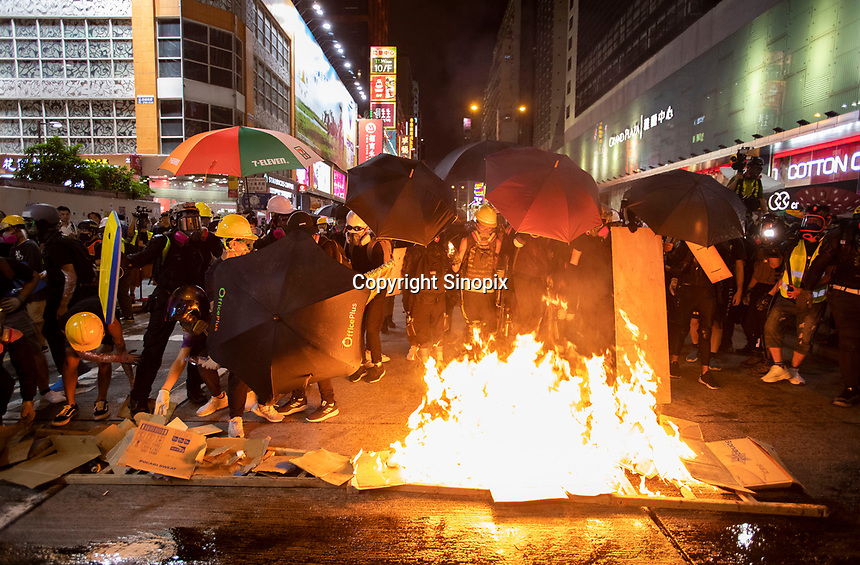 Anti-Extradition Bill protestors light a fire during a protest in Mong Kok, Kowloon, Hong Kong, China, 04 August 2019.