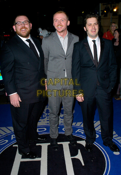 """NICK FROST, SIMON PEGG & EDGAR WRIGHT.attend the World Premiere of """"Hot Fuzz"""" .held at the Vue West End, London, England, .February 13, 2007..full length.CAP/CAN.©Can Nguyen/Capital Pictures"""