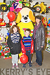 Aine and James Halligan and Paula O'Sullivan with the Toymaster puppy at the Easter party at Caball's Toymaster, Tralee on Saturday...