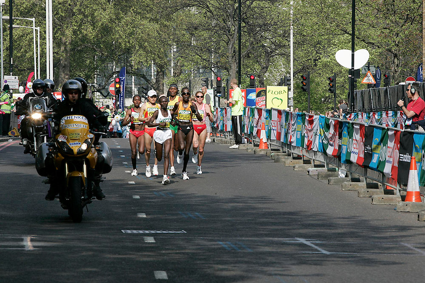 Lorna Kiplagat of the Netherlands heads the pack of elite women runners as it heads down The Highway.