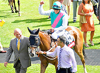 03.08.2013 Goodwood, England.  Winner's enclosure during day five of the  Glorious Goodwood Festival. Winner of the Feature race 3.15 The Markel Insurance Nassau Stakes (British Championship Series). Group 1- Winsili ridden by William Buick trained by John Gosden