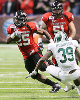 Texas Tech's Baron Batch, left, runs the ball past MSU's Trenton Robinson during the first half of the Valero Alamo Bowl, Saturday, Jan. 2, 2010, at the Alamodome in San Antonio. (Darren Abate/pressphotointl.com)