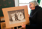 WATERTOWN,  CT-052119JS22- --Linda Merriman, President of the Watertown Historical Society, looks over a photo of the Watertown High School class of 1917 as they begin to move into its new home on Tuesday. <br /> Jim Shannon Republican American