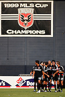 United players mob teammate  Earnie Stewart who just scored to put D.C. up 4-1. With this win  D.C. United takes over first place in the east and looks to reclaim past glory. D.C. United defeated the NY/NJ MetroStars 6 to 2 at RFK Stadium, Washington, D.C., on July 3, 2004.