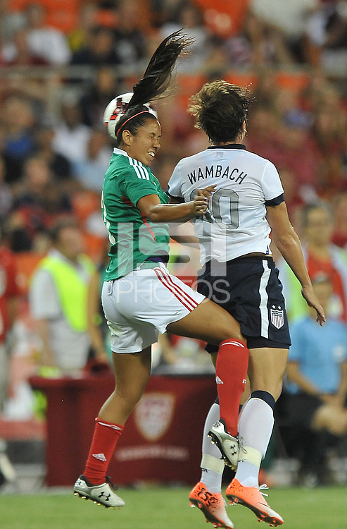 Bianca Sierra (3) of Mexico head the ball against USWNT Abby Wambach (20) The USWNT defeated Mexico 7-0 during an international friendly, at RFK Stadium, Tuesday September 3 , 2013.
