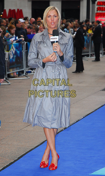 "JENNI FALCONNER.At the UK Film Premiere of ""Poseidon"", .Empire Leicester Square, London, .May 28th 2006..full length jenny grey dress coat red shoes flower blue carpet.Ref: CAN.www.capitalpictures.com.sales@capitalpictures.com.©Can Nguyen/Capital Pictures"