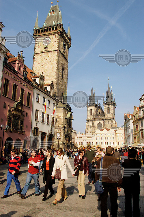 Tourists on Old Town Square (Staromestske namesti), with the Old Town Hall at left, on the exterior of which is the Astronomical Clock.