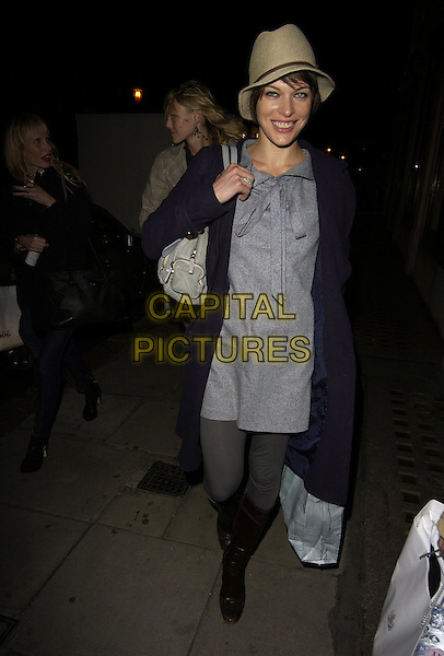 MILLA JOVOVICH.The Jovovich-Hawk clothing range UK launch, Harvey Nicholls, London, UK..April 27th, 2006.Ref: CAN.full length blue coat grey gray dress boots tights beige hat trilby.www.capitalpictures.com.sales@capitalpictures.com.©Capital Pictures