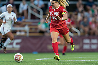 NEWTON, MA - AUGUST 29: McKenna Kennedy #26 of Boston University brings the ball forward during a game between Boston University and Boston College at Newton Campus Field on August 29, 2019 in Newton, Massachusetts.
