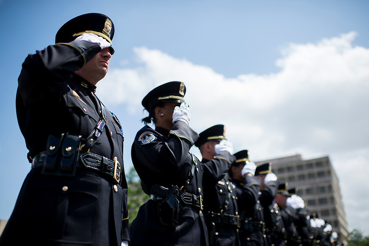 WASHINGTON, DC - MAY 11: U.S. Capitol Police honor guard members salute during the Washington Area Law Enforcement Memorial Service outside of DC Police headquarters on Monday May 11, 2015. The event held by the Fraternal Order of Police Auxiliary DC Lodge honored deceased local law enforcement officers, including U.S. Capitol Police Sgt. Clinton J Holz. (Photo By Bill Clark/CQ Roll Call)