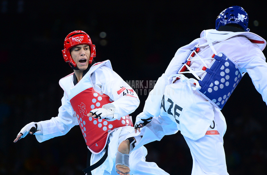 Aug 10, 2012; London , United Kingdom; Steven Lopez (USA), left, against Ramin Azizov  (AZE) in the men's 80kg preliminary during the London 2012 Olympic Games at ExCeL - South Arena 1. Mandatory Credit: Mark J. Rebilas-USA TODAY Sports
