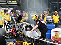 Jun 19, 2015; Bristol, TN, USA; NHRA top fuel team owner Bill Miller with driver Troy Buff during qualifying for the Thunder Valley Nationals at Bristol Dragway. Mandatory Credit: Mark J. Rebilas-