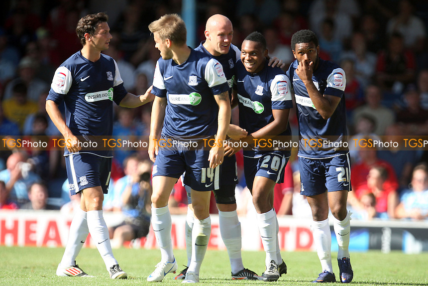 Britt Assombalonga (20) of Southend United is congratulated for scoring the opening goal - Southend vs Dagenham at the London Borough of Roots Hall Stadium  - 08/09/12 - MANDATORY CREDIT: Dave Simpson/TGSPHOTO - Self billing applies where appropriate - 0845 094 6026 - contact@tgsphoto.co.uk - NO UNPAID USE.