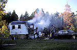 Volunteer firefighters at house trailer fire, Ontario, Canada