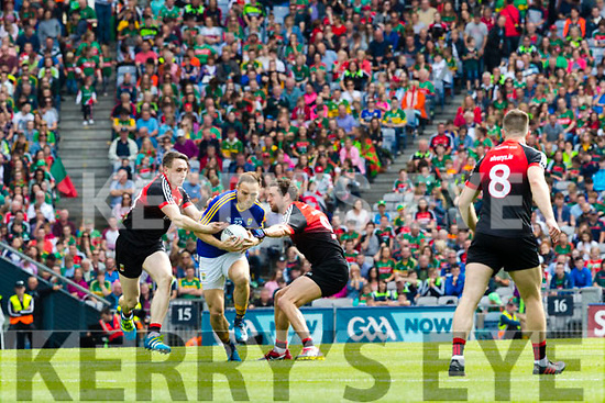 Darran O'Sullivan Kerry in action against Paddy Durkin and Tom Parsons Mayo in the All Ireland Semi Final Replay in Croke Park on Saturday.