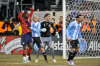 Jozy Altidore (17) of the United States and Esteban Cambiasso (5) of Argentina fight for position. The United States (USA) and Argentina (ARG) played to a 1-1 tie during an international friendly at the New Meadowlands Stadium in East Rutherford, NJ, on March 26, 2011.