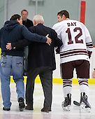 Longtime Army coach and father of Army's current coach Jack Riley is helped off the ice by ? and Brian Day (Colgate - 12). - The host Colgate University Raiders defeated the Army Black Knights 3-1 in the first Cape Cod Classic at the Hyannis Youth and Community Center in Hyannis, MA.