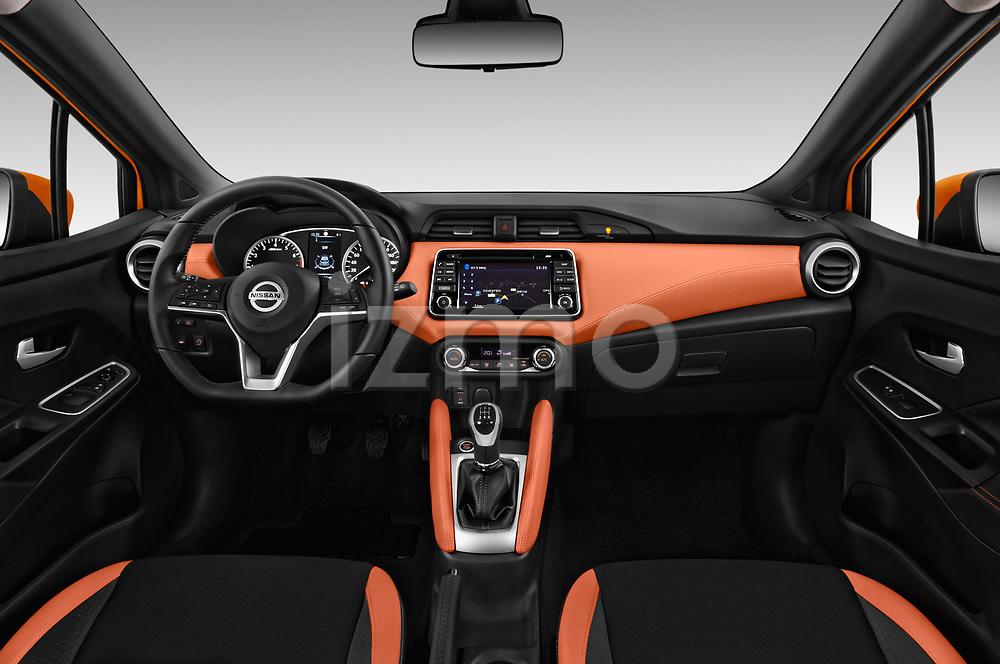 Stock photo of straight dashboard view of 2017 Nissan Micra Tekna 5 Door Hatchback Dashboard