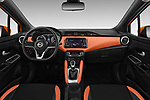 Stock photo of straight dashboard view of 2017 Nissan Micra Tekna 5 Door Hatchback Dashboard